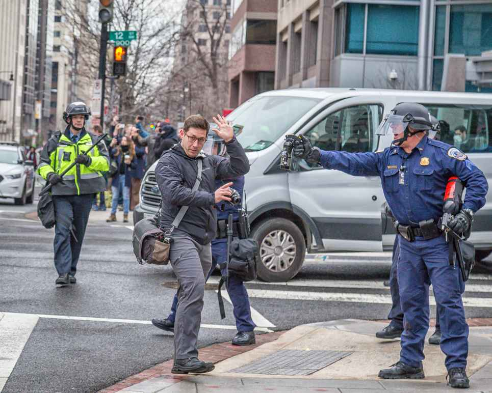 Police Menaces Photographer with Pepper-Spray