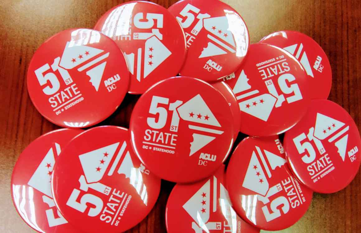 red statehood buttons that read 51st State