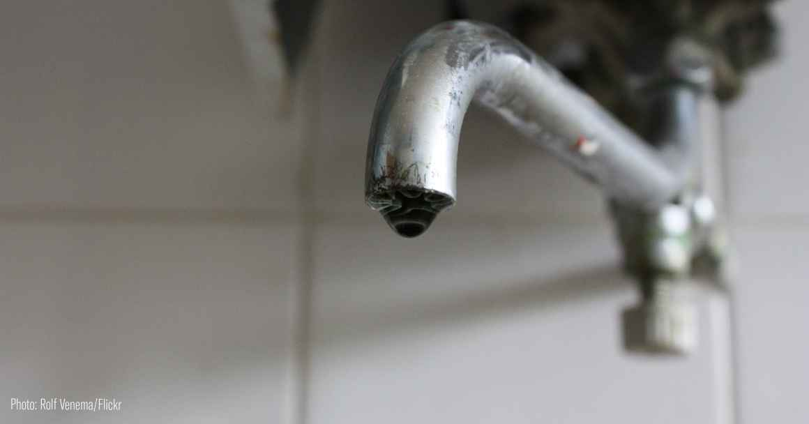 photo of faucet with drop of water